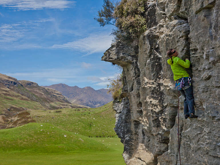 Climbing a crack on the lead climbing course, Hospital Flat, Wanaka
