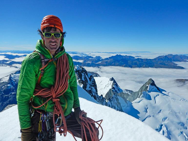 Standing on the summit of Mt Aspiring