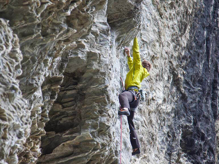 Rock climbing on steep schist upper Harolds wall Wye Creek Queenstown